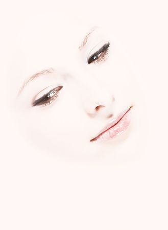 Close-up of fresh young beautiful woman face. On pink background photo
