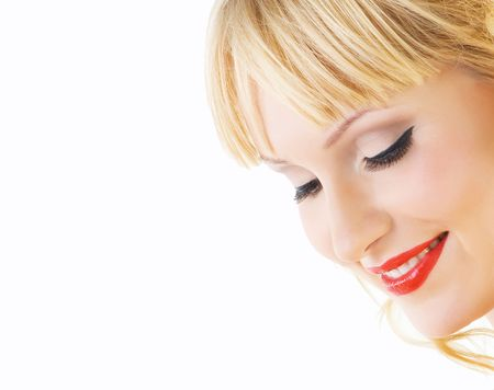 Close-up beautiful fresh bright young blonde smiling in studio shot with beautiful make-up photo