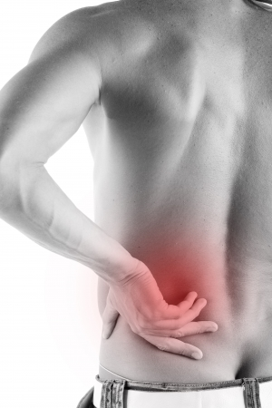 Muscular man touching his back in pain on white background Stock Photo - 5434477