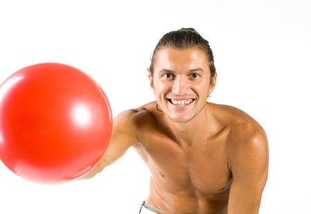 chest hair: Young handsome and sexy male athlete with ball isolated on white background Stock Photo