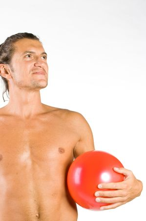 Young handsome and sexy male athlete with red ball isolated on white photo