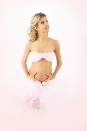 Beautiful blonde pregnant woman in pink on pink background Stock Photo - 5454769
