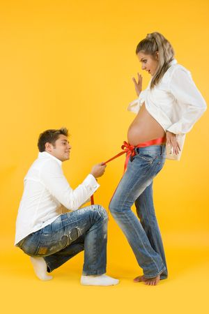 Future mother and father on yellow background Stock Photo - 5454807
