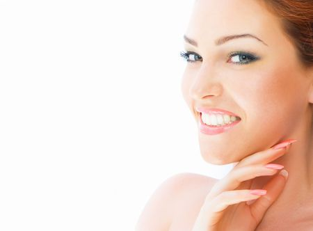 Close-up beautiful luxury fresh bright young lady touching her face photo