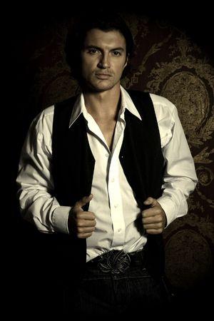 Sexy man on black background in studio shot