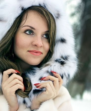 Beautiful lady in fur in the winter photo