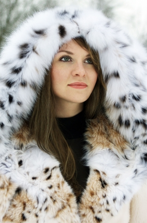 Beautiful brunette lady in fur coat in the winter Stock Photo