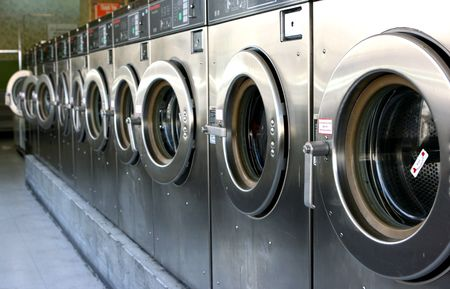 vandal: Public laundry machines standing in a row