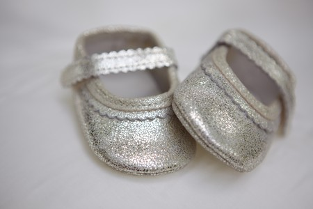bootees: Small silver babys bootees in studio shot
