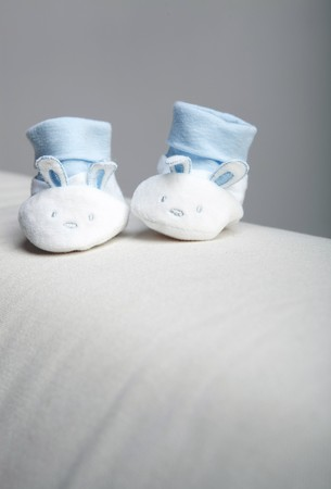 bootees: Blue and white babys bootees in studio