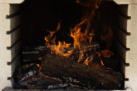 Firewood burning fire flames on a brazilian churrasco