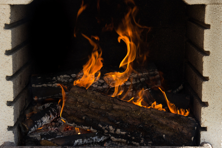 Firewood burning fire flames on a barbecue