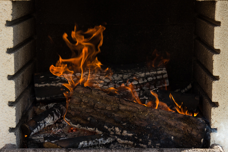 Firewood burning fire flames on a argentinian asado Stock Photo