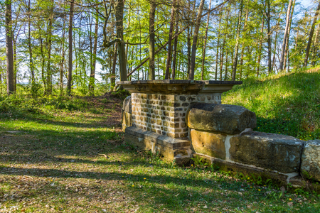 Old roman empire tumulus grave in a forest from Luxembourg, north europe Stock Photo
