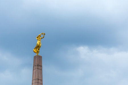 LUXEMBOURG, LUXEMBOURG - April 28, 2017: Monument of Remembrance (Gelle Fra, Golden Lady) is memorial dedicated to Luxembourgers who volunteered for service in armed forces of Allied Powers during WWI. Dramatic Sky Editorial