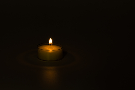 Small Lit Candle With Soft Light Isolated On Dark Background Stock Photo Picture And Royalty Free Image Image 77467355