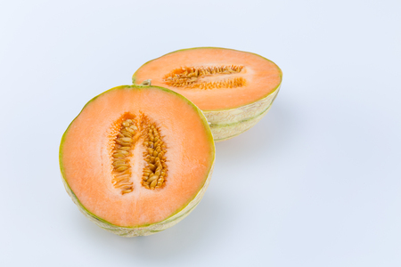 Open sliced fresh Charentais Melon isolated on white background