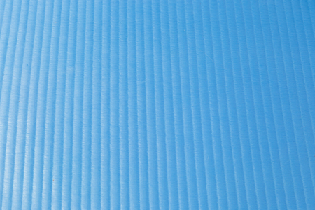 Texture of a rubber blue vertical striped shine gym mat Stock Photo