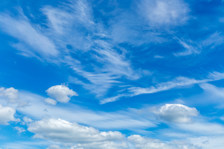 Blue sky with sculpted clouds on the background