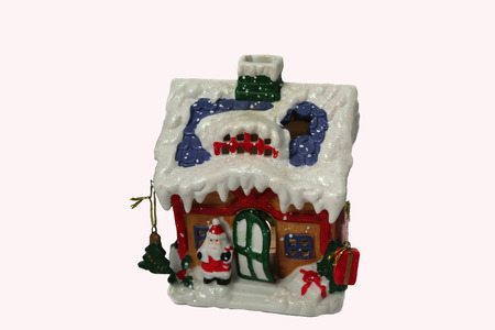 fabulous: Fabulous snow-covered Christmas house with Santa Claus and gifts.
