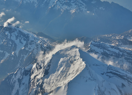 cloud capped: Snow-capped mountain peaks of the Alps to the altitude of the aircraft.