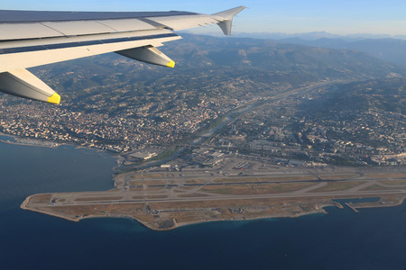 seaboard: View the Cote dAzur, Var river, Alps mountains and Nice airport with flight altitude of the aircraft. Stock Photo