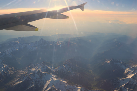 Snow-capped mountain peaks of the Alps to the altitude of the aircraft. photo