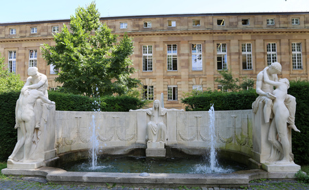 Fate fountain in Stuttgart, Germany, Fountain of Destiny in the Palace garden on a summer day.The fountain shows the goddess of destiny and two pairs of lovers, symbolizing agony and joy. Editorial