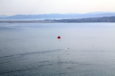 Aerial perspective of the sea, parasailing and city Nice from the Castle Hill.