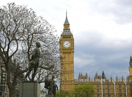 London, Great Britain -May 22, 2016: statues to Jan Smuts, David Lloyd George and Winston Churchill in the Parliament Square with the Big Ben and the Houses of Parliament in the background Editorial