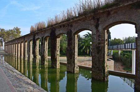 Aqueduct in urban park El Clot of Barcelona.