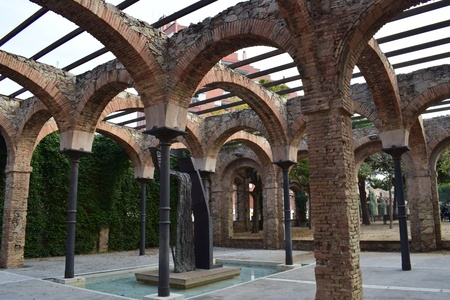 Architectural arcade in Industrial old workshop converted into public park.