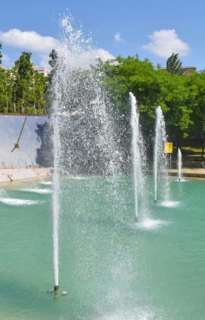 Water jet in public garden of Barcelona Stock Photo