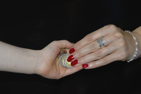 Young mother giving euro coins to the child photo