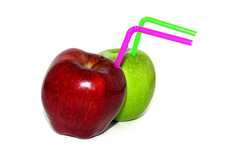 Two isolated apples with coctail straws on a white background photo