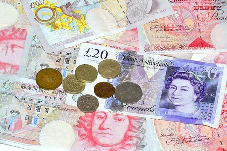 A lot british banknotes and old coins Stock Photo - 10495435