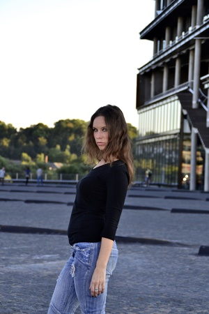 Girl standing in front of the modern building photo