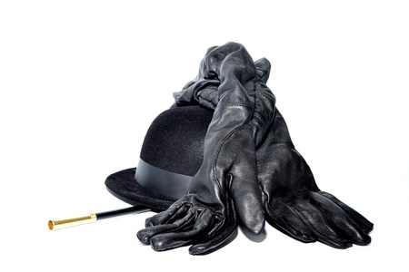 bowler: Black gloves, magic wand and bowler hat isolated on white Stock Photo
