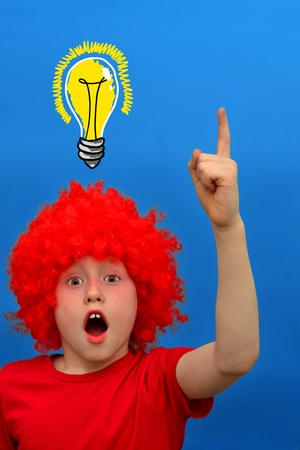 Funny boy in red curly wig makes discovery photo