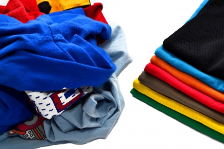 rumpled: Stack of folded and clean shirts vs pile of dirty clothes Stock Photo