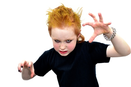 Rebel kid with yellow hair making scary face photo
