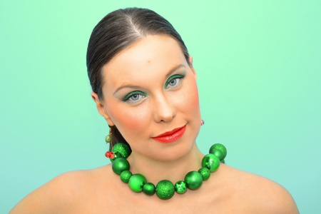 Portrait of an attractive slav woman in green decoration Stock Photo - 12076865