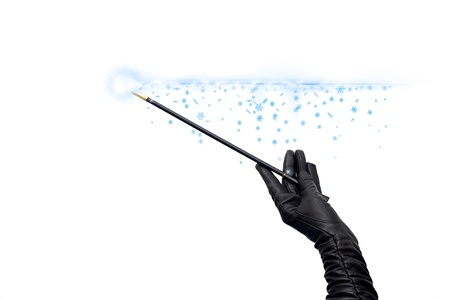 fairy wand: Magician handsin long black glove holding magic wand and casting spell Stock Photo