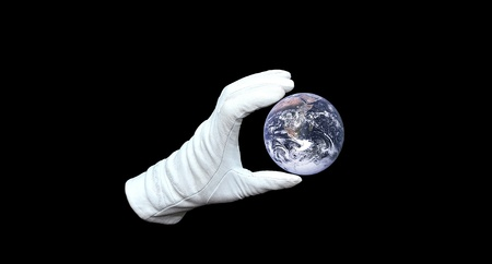 Hand in white glove holding world globe Stock Photo - 12929840