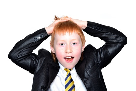 Office redhead boy holds his head and looks surprised photo