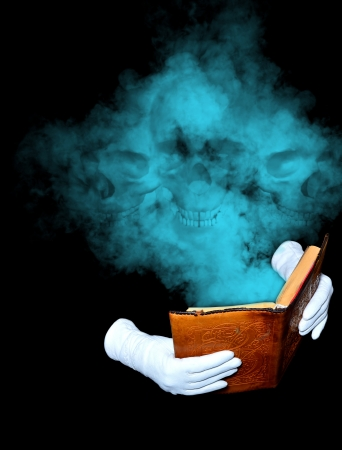 Magic book in leather-bound held by hands in white gloves photo
