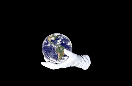 Hand in white glove holding Earth globe Stock Photo