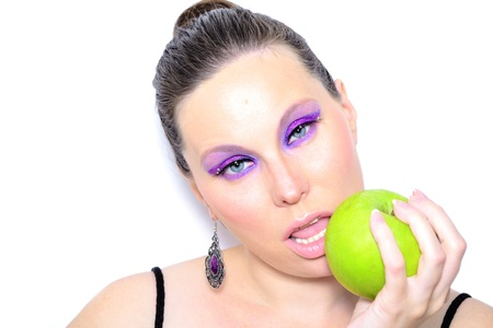 Portrait of a beautiful female with green apple in her hand photo