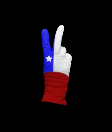 Hand with victory gesture in a glove decorated with Chilean flag photo