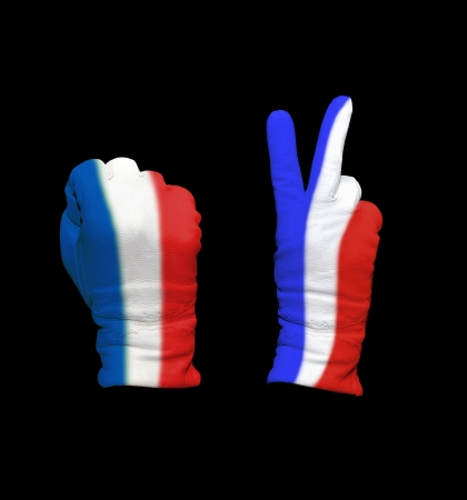Clenched fist in leather glove, and hand with victory gesture in a glove decorated with France  flag photo